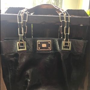 A ya Hindmarch Black Patent Leather Handbag